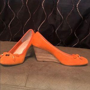 Orange suede wedges